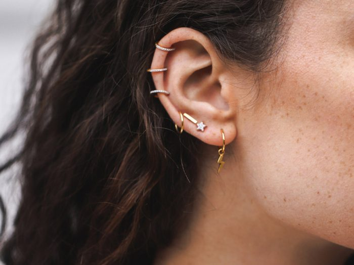 stud earrings in gold and silver