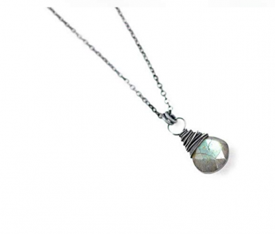 """Be the first to review this item Black Oxidized Sterling Silver Labradorite Gemstone Pendant Necklace - 16"""" Length This necklace features a small labradorite gemstone with tons of blue flash that labradorite gems are known for! The pendant has been wire wrapped by hand in sterling silver wire and hangs from delicate sterling cable chain and finished with a spring clasp closure. The necklace has then been oxidized, sealed and polished. The stone measures approximately 10mm in size. Price: $49.95 & FREE Shipping on eligible orders. Details In Stock. Sold by Starletta Designs and Fulfilled by Amazon. This item does not ship to Croatia. Please check other sellers who may ship internationally. Learn more Deliver to Croatia Qty: Qty:1 Add to Cart Add to List Starletta Designs Handmade Gemstone & Wire Wrapped Jewelry in Canada Contact me with general inquiries Featured Artisans Share Are you an Artisan? Apply to join Handmade at Amazon"""