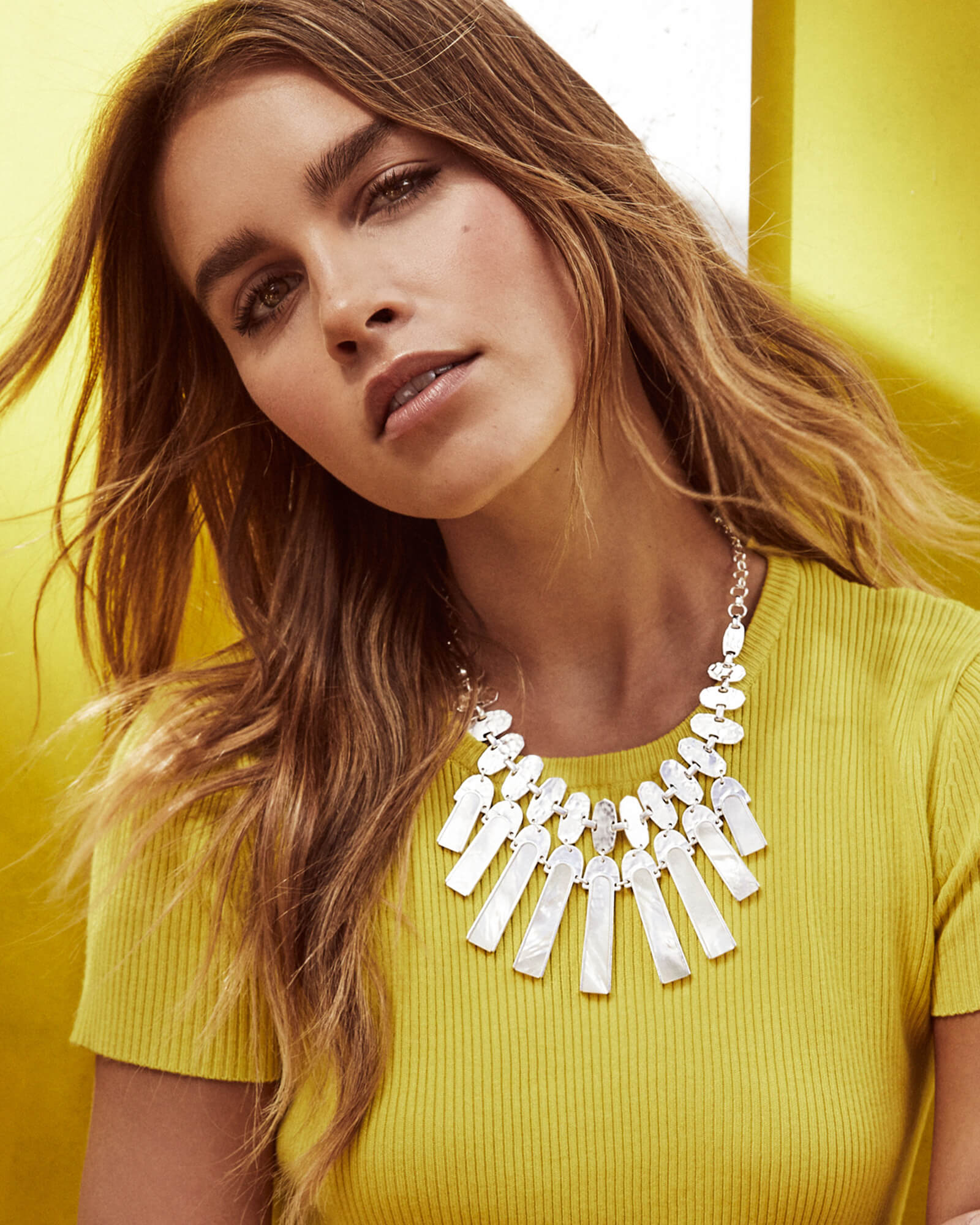 wearing a statement necklace