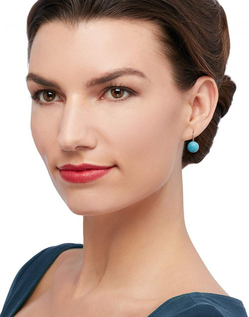 Model with turquoise earrings