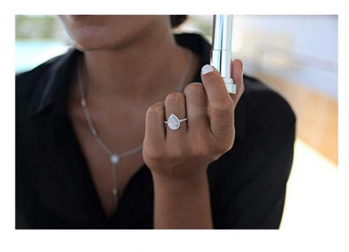 Lemon grass pear-shaped engagement ring on model
