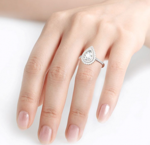 Jeulia pear-shaped engagement ring on hand