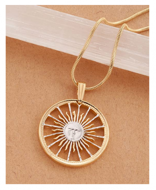 The Difference World Coin Jewelry Sunface Necklace on Display